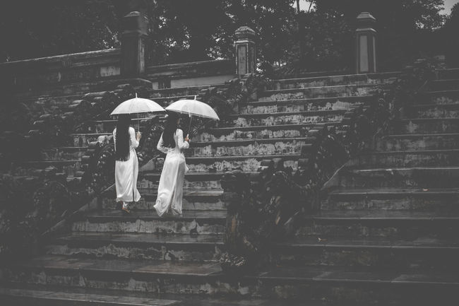 2 Women Ao Dai Vietnam Architecture Back And White Day Full Length Leisure Activity Lifestyles Men Outdoors People Rainy Day Real People Staircase Steps Steps And Staircases Togetherness Two People Umbrella Under Walking Women Young Adult The Week On EyeEm EyeEmNewHere EyeEmNewHere Adventures In The City