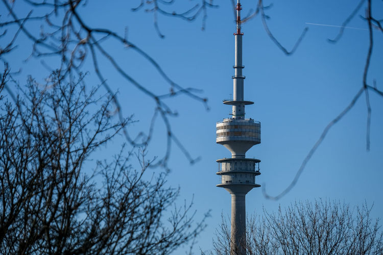 Low angle view of rheinturm tower against clear sky
