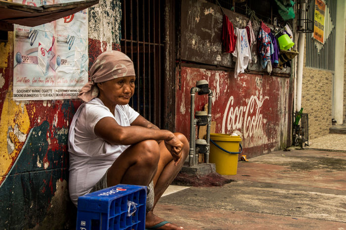 Surrounded by cola, Intramural, Manila. October 5, 2016. Photo by Olga Mihova Everydayasia Everydayphilippines EyeEm Gallery Intramuros Manila Street Street Photography Streetphotography