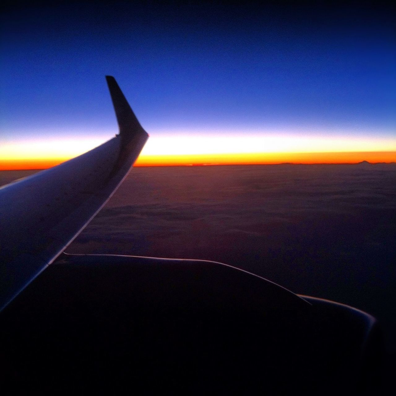 CROPPED IMAGE OF AIRPLANE WING