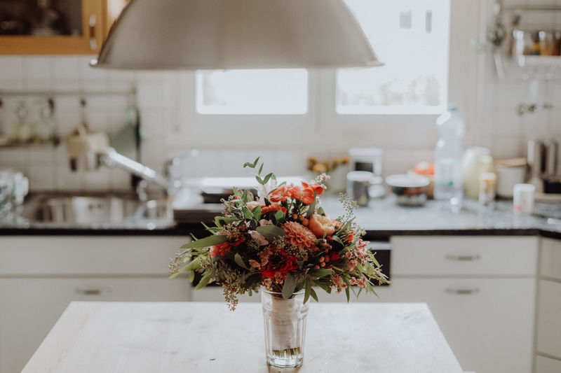 Beautiful wedding bouquet standing on a kitchen table Modern Natural Natural Light Wedding Bouquet Wedding Photography Bouquet Close-up Colorful Day Domestic Life Flora Florist Flower Flower Head Flowers Focus On Foreground Home Interior Indoors  Kitchen No People Table Vase Wedding Day Fresh On Market 2017