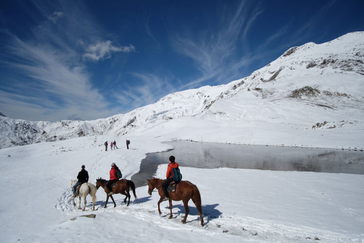 Horse riding to the top of the snow cap mountain. Animal Cold Temperature Georgia Horse Riding Nature People Snow Svaneti Georgia Travel Travel Destinations
