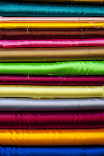 Variety of silk materials stacked on each other
