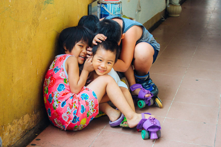 """""""Oh no, photographer!!! Hide your face, quick!!!"""", they yelled as they gathered keeping their faces hidden in giggles and laughter Beauty In Ordinary Things Childhood Children Children Photography Cute Daily Life Fun Hide Innocence Kid Mischievous Naive Play Time Real People Saigon The City I Live In Vietnam Vietnamese Street Photography Showcase March Here Belongs To Me The Portraitist - 2016 EyeEm Awards The Street Photographer - 2016 EyeEm Awards The Photojournalist - 2016 EyeEm Awards"""
