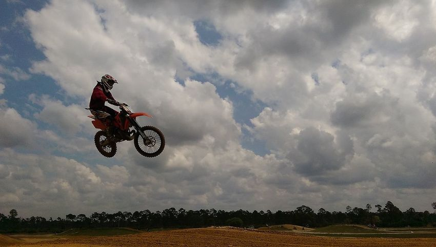 My bf, doing what he loves Motorcross  Flying High 888