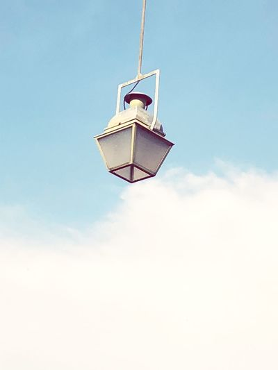 Low angle view of gas light hanging against sky