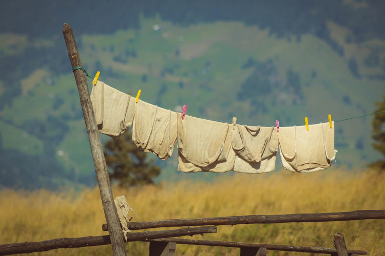 Close-up Clothesline Clothespin Day Drying Focus On Foreground Hanging Laundry Nature No People Outdoors Sky