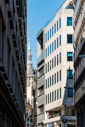 Cityscape of city center of Madrid Architecture Building Exterior Built Structure Building City Window Low Angle View Day Sky Nature No People Sunlight Clear Sky Residential District Outdoors Blue Shadow In A Row Tower City Life Apartment Cityscape Madrid City Rental Architecture