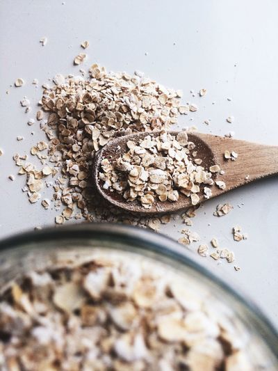 Raw oats Food And Drink Food Ingredient High Angle View Table Indoors  Healthy Eating No People Cereal Plant Freshness Close-up Sesame Seed Oatmeal Flatlay Flat Lay Raw Ingredients Ingredients Wooden Spoon Cooking Ingredient Raw Food Photography Food Flat Lays Jar Grain Whole Grain
