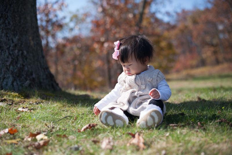Cute girl sitting on grass