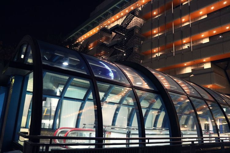 Skyscraper Mode Of Transportation Office Travel Nature Travel Destinations Office Building Exterior Connection Transportation Modern Outdoors Lighting Equipment Building Low Angle View City No People Building Exterior Built Structure Architecture Night Illuminated Retro Futuristic