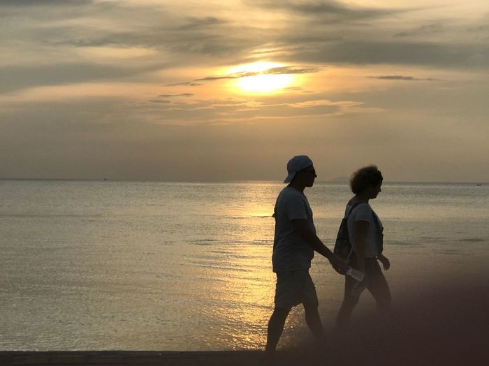 Sunset Sky Water Two People Sea Beauty In Nature Beach Leisure Activity Land Cloud - Sky Orange Color Real People Lifestyles Horizon Over Water Positive Emotion Outdoors Togetherness Women Child Nature Summer In The City