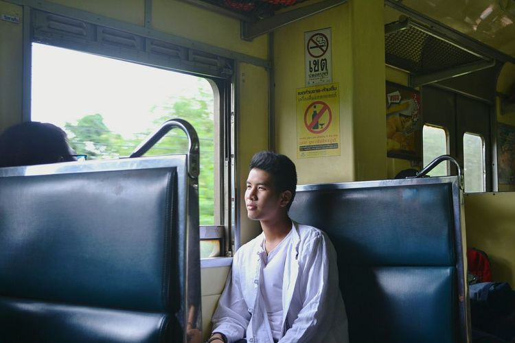 Young woman traveling in train