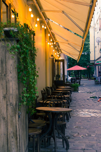 Architecture Cafe Time Cafeteria Style Caffè Electric Light Evening Evening Light Illuminated Ivano-frankivsk Lights No People Old Town Old-fashioned Outdoors Outside Reflection Romantic Street Street Photography Table And Chairs Van Gogh World