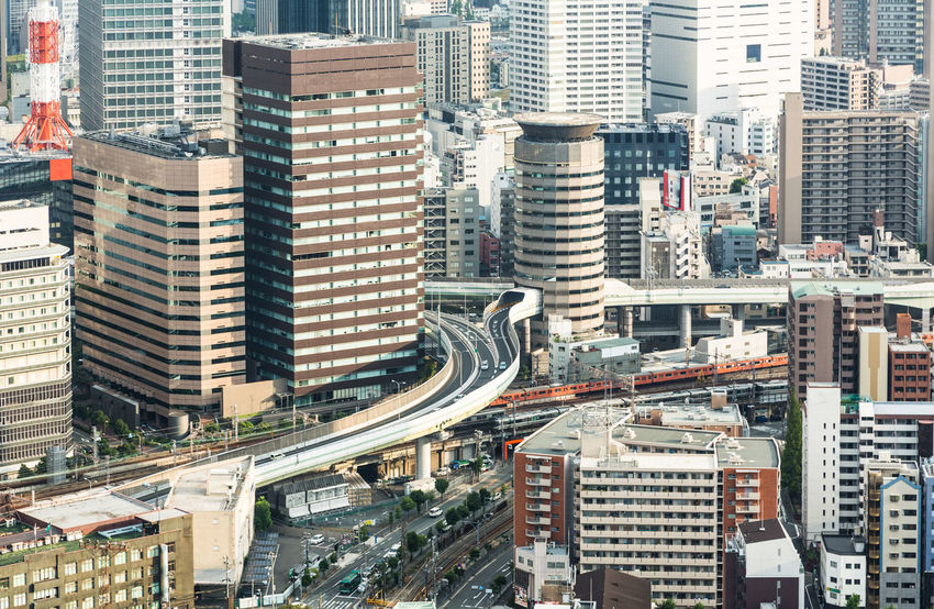 Osaka skyline in the Kansai province of Japan. Osaka is one of Japan largest city. Aerial View Architecture ASIA Building Exterior Built_Structure City City Life Cityscape Crowded Day Elevated Road High Angle View Japan Kansai Modern OSAKA Outdoors People Road Skyscraper Street Transportation Travel Urban Skyline Fresh On Market 2017