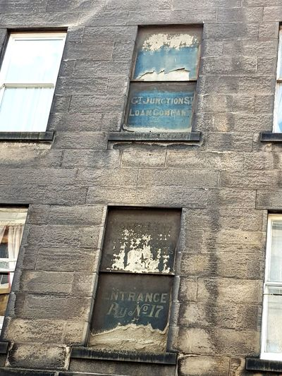 Old signs on Great Junction Street in Edinburgh. Early 19th Century Early 1800s Communication Window Full Frame Text Architecture Building Exterior Close-up Built Structure Information Sign Deterioration