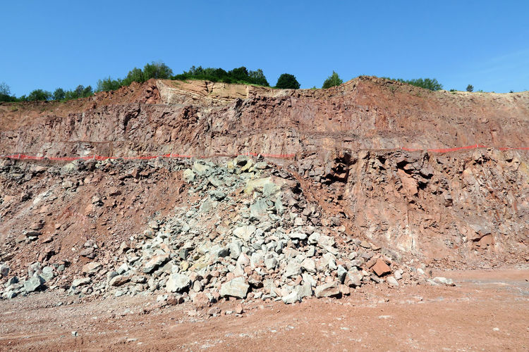 a quarry mine. porphyry rock material. Open Pit Mining Quarry Rock Outdoors Mountain Surface Mine Surface Mining Mining Mine Mining Heritage Open Pit Mine Quarry