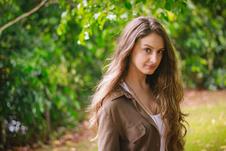 Beautiful Woman Beauty Day Focus On Foreground Lifestyles Long Hair Looking At Camera Nature One Person One Young Woman Only Outdoors People Portrait Real People Standing Tree Young Adult Young Women