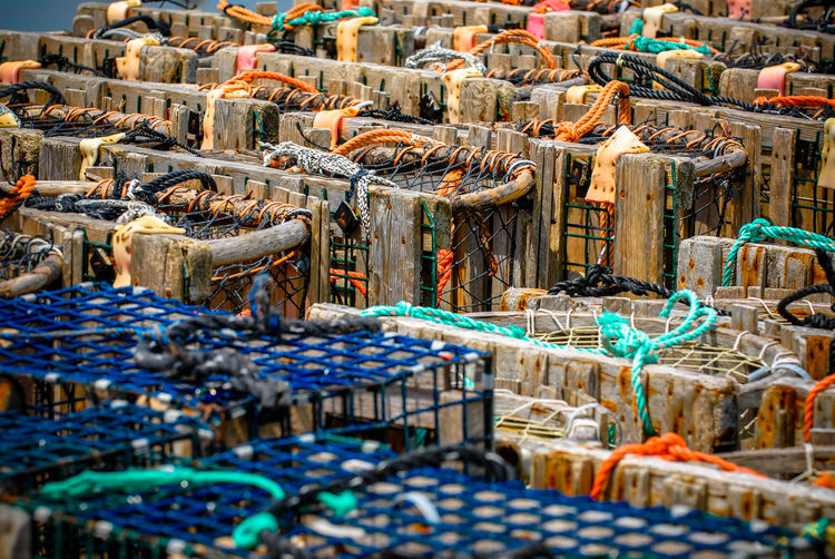 lobster cage Lobster Lobster Traps Abundance Arrangement Business Day Fish Fishing Fishing Industry Fishing Net Food And Drink Industry Large Group Of Objects Lobster Cages Nature Nautical Vessel No People Outdoors Seafood Selective Focus Stack Sunlight Wood - Material The Street Photographer - 2018 EyeEm Awards