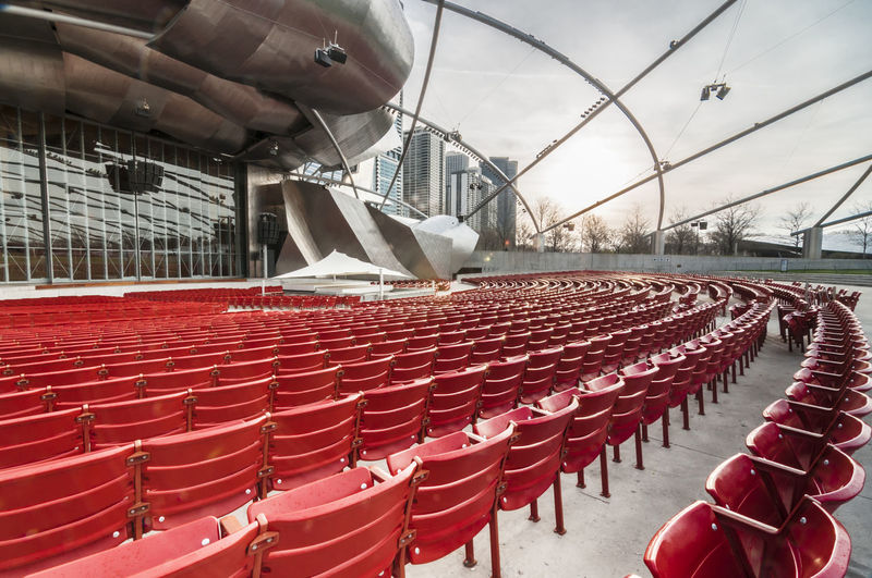 Jay Pritzker Pavilion Jay Pritzker Pavillion Stage Chair Day In A Row Large Group Of Objects Outdoors Real People Red Seat Seatings Sky Stadium