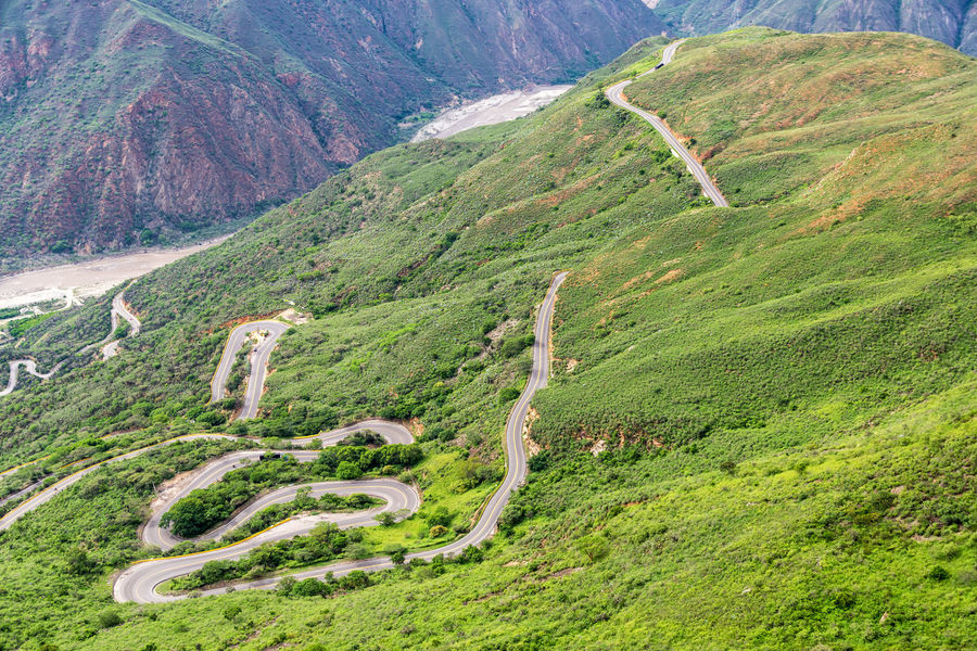 Switchback road running through Chicamocha Canyon near Bucaramanga, Colombia Chicamocha Canyon Cliffs Colombia Green Nature Panachi Santander Scenic Travel Tree Trees View Aerial Bucaramanga Canyon Chicamocha Landscape Mountain Mountains Outdoor Park River Tourism Vacation Wire