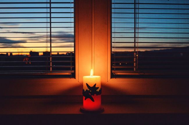 Home Home Sweet Home Christmas Lights Christmastime Lights Multi Colored Flame Burning Heat - Temperature Indoors  Glowing Sunset Candle Window No People Illuminated Close-up Sky HUAWEI Photo Award: After Dark Holiday Moments