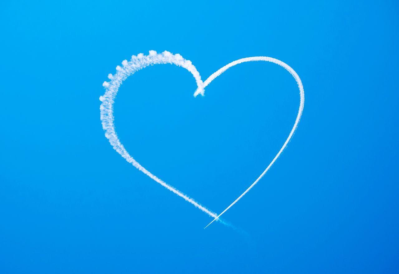 Vapor Trail Of Heart Shape In Blue Sky