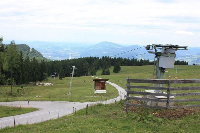 Grass Protection Scenics Sky Tranquility Mountain Nature Field Beauty In Nature Day No People Landscape Cloud - Sky Tranquil Scene Outdoors Tree Ski Lift in Summertime
