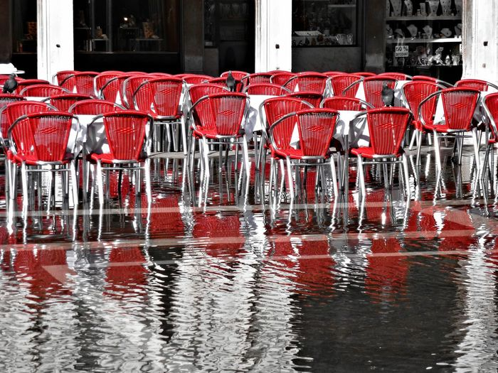 Empty red chairs with waterfront