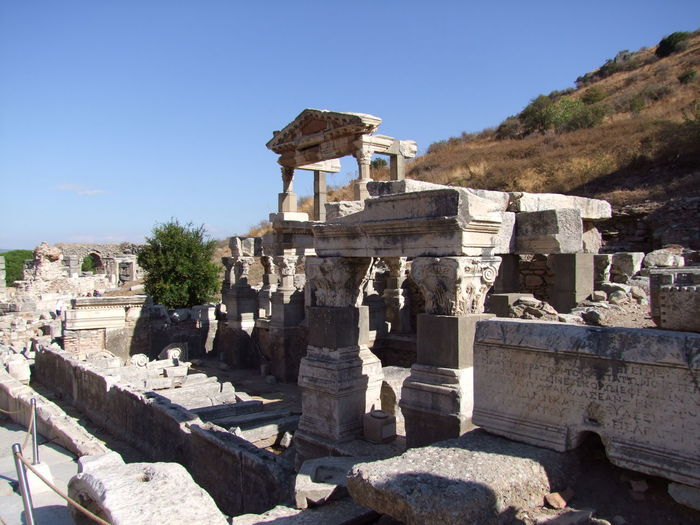 Old Ruins Of Temple Of Hadrian Against Sky