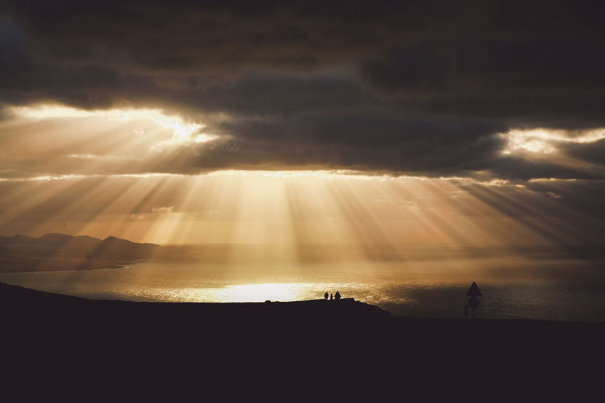 Canary Islands Lanzarote Rays Of Light SPAIN Silhouettes Travel Volcanoes Clouds Day Geological Formation Island Landscape Rays Rays Of Sunshine Sea Shore Sunset Volcanic  Volcano