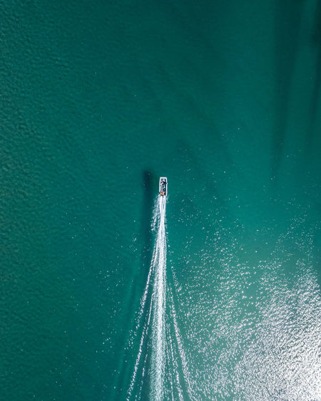 Aerial view of boat sailing on sea