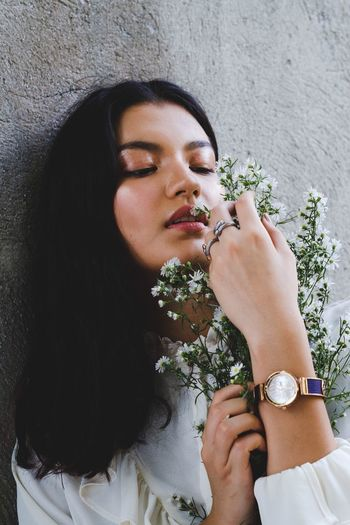 For Charriol Philippines Eyes Closed  Holding Only Women Adults Only One Woman Only One Person Marijuana - Herbal Cannabis Flower Lifestyles Plant Adult Young Women People Beautiful Woman Beauty Women Real People Young Adult One Young Woman Only Close-up