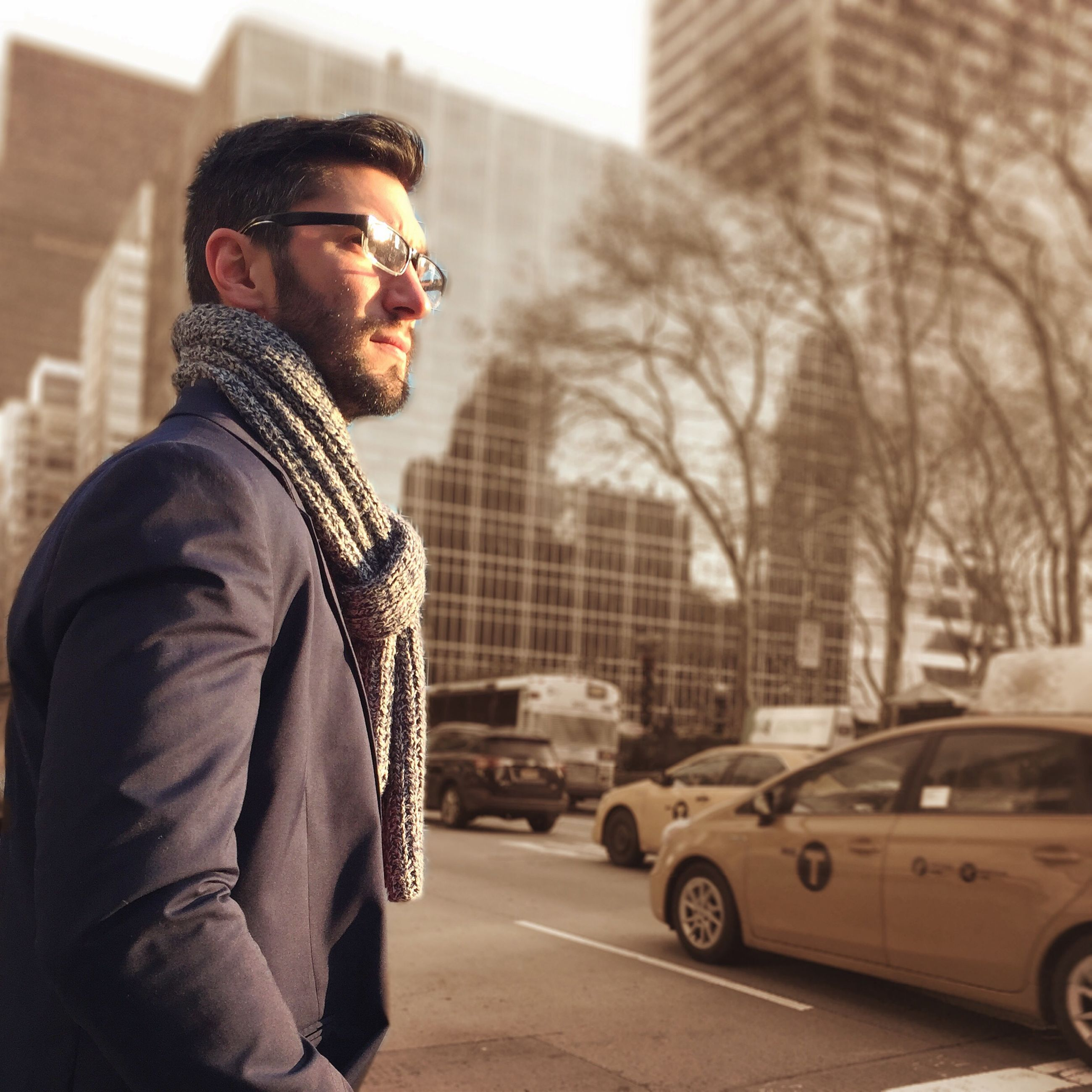 young adult, lifestyles, young men, person, casual clothing, leisure activity, transportation, land vehicle, car, mode of transport, building exterior, looking at camera, architecture, portrait, side view, front view, built structure, sunglasses