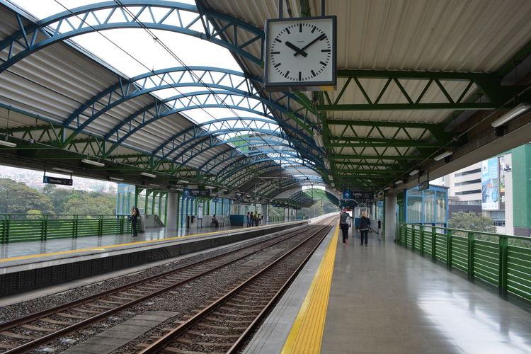 Clock hanging at railroad station