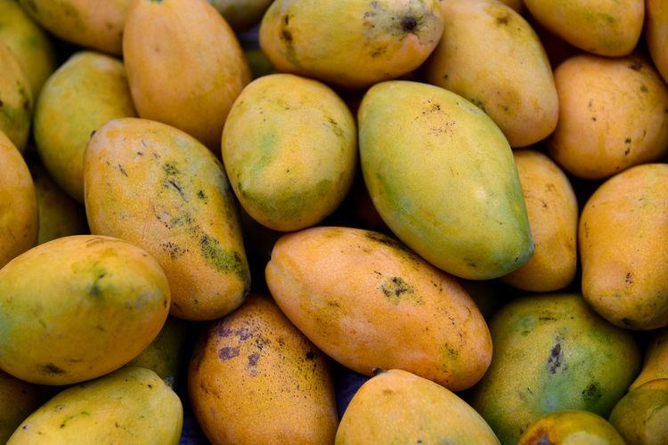 Full frame shot of mangoes for sale in market