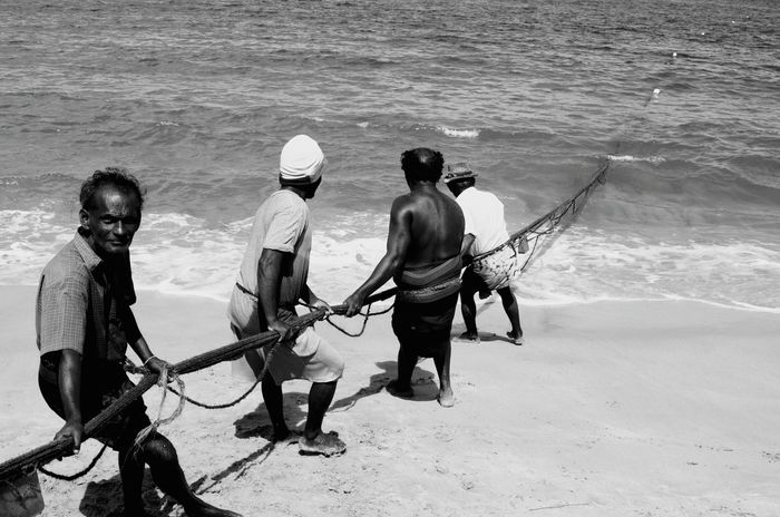 Fishermen Fishing Time Fishe Fishes Fishinglife Fishermen's Life Fishing Beach Work In Progress Lifestyle Photography Sri Lanka Srilankan Water Togetherness Full Length Leisure Activity Rear View Lifestyles Men Sea Sitting Beach Casual Clothing Shore Vacations fishing net people and places
