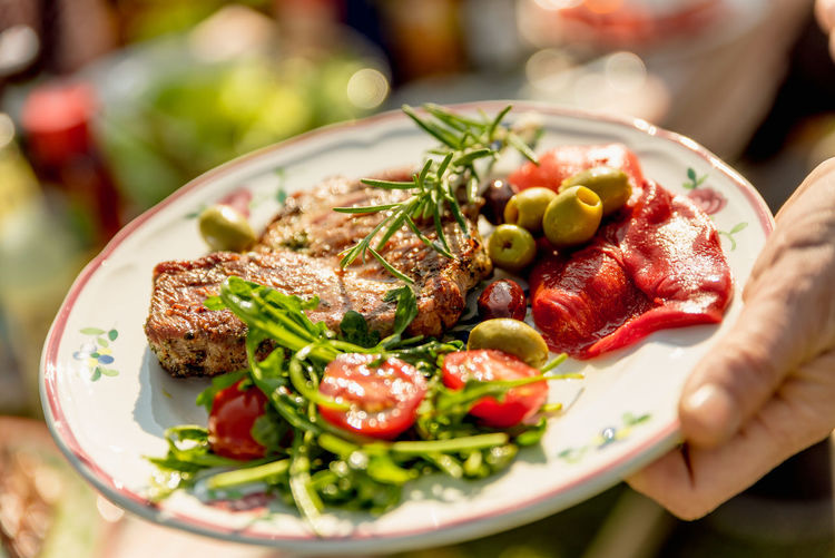 BBQ Barbecue Close-up Crockery Food Food And Drink Freshness Fruit Hand Healthy Eating Herb Human Body Part Human Hand Lifestyles Meat One Person Plate Ready-to-eat Real People Selective Focus Table Vegetable Wellbeing