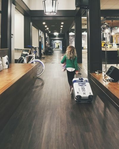 Indoors  Full Length One Person Young Adult Girl Hotel R2D2 Suitcase Real People
