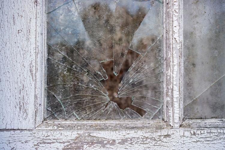 Digital composite image of people on glass window