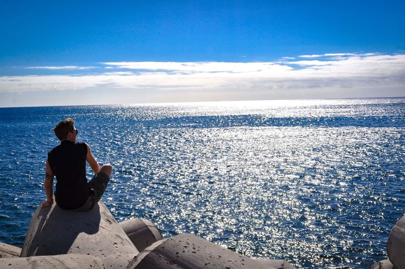 Sea Water Rear View Horizon Over Water Tranquil Scene Sitting Scenics Cloud - Sky Sky Nature Relaxation