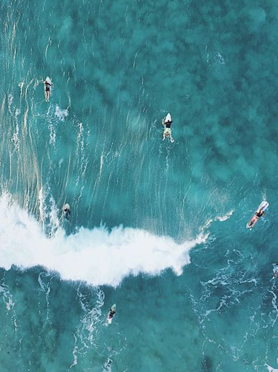 Directly Above Shot Of People Surfing In Sea