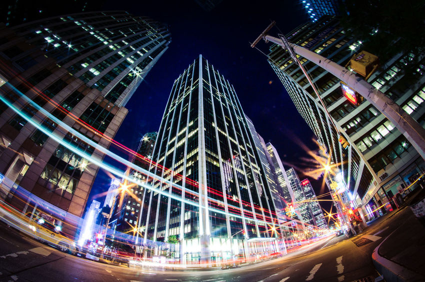 Cityscape Night Lights Architecture Blurred Motion Building Exterior Built Structure City Fisheye Illuminated Long Exposure Low Angle View Modern Motion Night No People Skyscraper Speed Mobility In Mega Cities