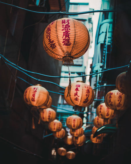 Low angle view of lanterns hanging at market