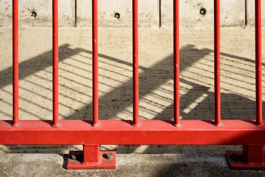 Urban abstract photography Close-up Color Colorful Concrete Concrete Floor Concrete Wall Day Detail Detailphotography Fence Lines Lines And Shapes Metal Metal Bars No People Red Shadow Shadows Shadows On The Floor Urbanphotography