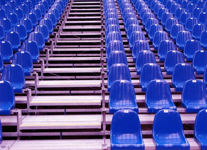 Blue empty chairs arranging in stadium