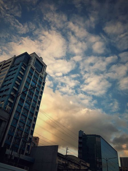 Clouds over Quezon City Philippines Architecture Building Exterior Built Structure Sky Skyscraper Low Angle View Sunset City Cloud - Sky Outdoors EyeEmNewHere