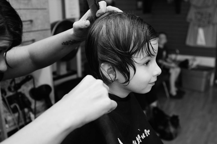 Close-Up Of Girl Getting A Hair Cut