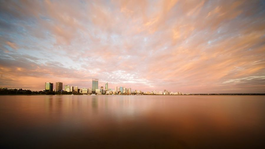 Spectacular sunset after the hottest day in 2 years EyeEm Selects Water Sky Architecture Building Exterior Reflection City Built Structure Building Travel Destinations Sunset Cityscape Outdoors Skyscraper Cloud - Sky Urban Skyline No People Office Building Exterior