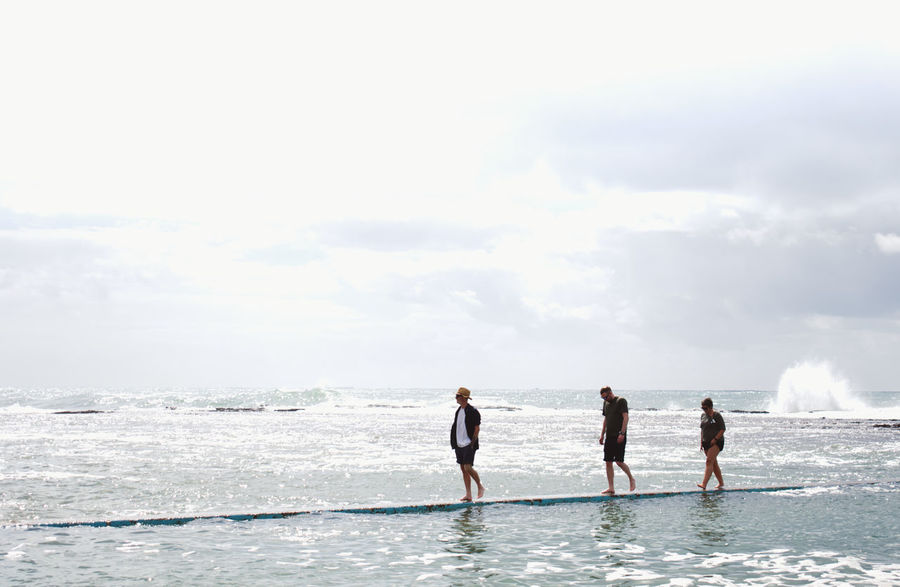 3 people walking on water Adult Adventure Adventure Club Aquatic Sport Australia Beach Collaroy Day Friendship Full Length Hello World Horizon Over Water Nature Outdoors People Sea Sky Sport Summer Togetherness Vacations Water